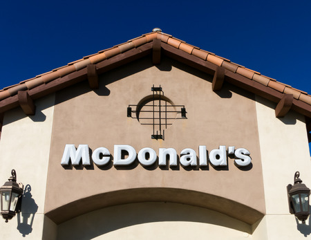 mc: SANTA CLARITA, CAUSA - NOVEMBER 17, 2014: Contemporary McDonalds exterior. The McDonalds Corporation is the worlds largest chain of hamburger fast food restaurants. Editorial