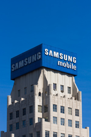 samsung: LOS ANGELES, CAUSA - NOVEMBER 29, 2014: Samsung Mobile advertisement and logo. Samsung is a South Korean multinational conglomerate company.