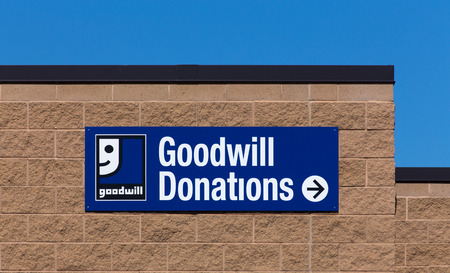 goodwill: BLOOMINGTON, MNUSA - JUNE 21, 2014:  Goodwill store exterior sign. Goodwill Industries is a nonprofit organization that provides job training programs for people with disabilities.