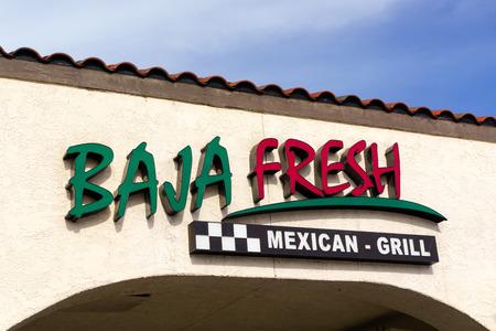 northridge: NORTHRIDGE, CAUSA - DECEMBER 19, 2014: Baja Fresh Mexican Grill restaurant exterior. Baja Fresh is a chain of fast-casual Tex Mex restaurants headquartered in Irvine, California. Editorial