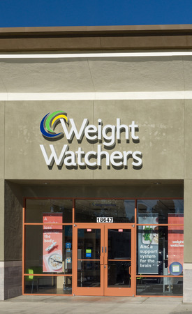 weight gain: GRANADA HILLS, CAUSA - DECEMBER 26, 2014: Weight Watchers International exterior and sign. Weight Watchers offers various products and services to assist weight loss and maintenance. Editorial