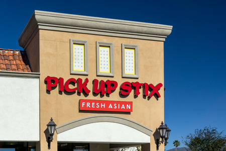 franchises: GRANADA HILLS, CAUSA - JANUARY 6, 2015: Pick up Stix Fresh Asian restaurant. Pick Up Stix is restaurant chain that serves fresh Asian cuisine through corporate-owned restaurants and franchises in Southern California.