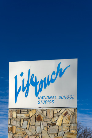 headquartered: EDEN PRAIRIE, MNUSA - JANUARY 18, 2015: Lifetouch Portrait Studios headquarters sign. Lifetouch Inc. is an employee-owned photography company headquartered in Eden Prairie, Minnesota.