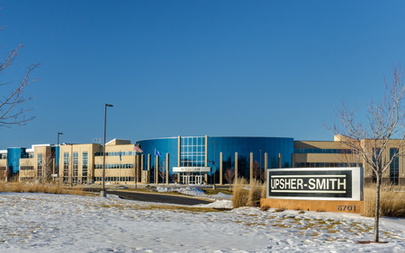 pharmaceutical company: MAPLE GROVE, MNUSA - JANUARY 18, 2015: Upsher-Smith Laboratories headquarters and sign. Upsher-Smith Laboratories is a privately owned pharmaceutical company headquartered in Maple Grove, Minnesota. Editorial