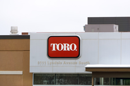 BLOOMINGTON, MNUSA - JANUARY 21, 2015: The Toro Company world headquarters. Toro is an American manufacturer of lawn mower and snow removal equipment. Редакционное