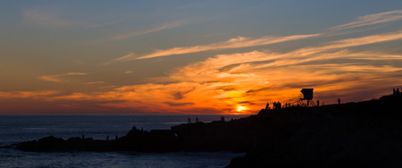 ocean state: Silhouette of people watching the sun set over the Pacific Ocean at Leo Carillo State Beach Stock Photo