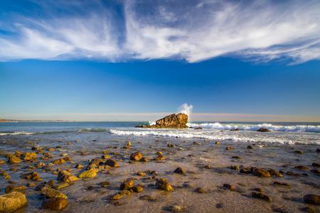 Waves crashing on rocks at low tide at Leo Carillo State Beach in Malibu, California