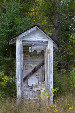 disrepair: Dilapidated Outhouse in the Rural Wisconsin Countryside
