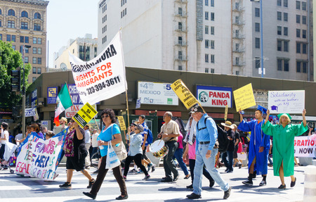 illegal alien: LOS ANGELES, CAUSA - MARCH 28, 2015:  Unidentified participants in an immigration reform rally in the United States. Editorial