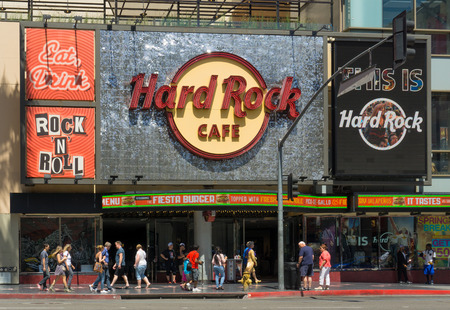 hard rock cafe: HOLLYWOOD, CAUSA - APRIL 18, 2015: The Hard Rock Cafe on Hollywood Boulevard. The Hard Rock Cafe is a chain of rock and roll memorabilia themed restaurants.