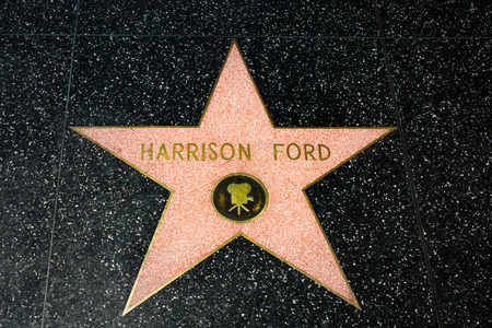famous industries: HOLLYWOOD, CAUSA - APRIL 18, 2015: Harrison Ford star on the Hollywood Walk of Fame. The Hollywood Walk of Fame is made up of brass stars embedded in the sidewalks on Hollywood Blvd.
