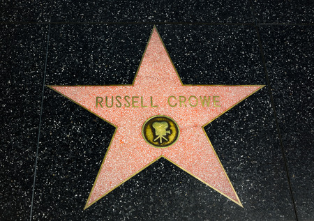 famous industries: HOLLYWOOD, CAUSA - APRIL 18, 2015: Russell Crowe star on the Hollywood Walk of Fame. The Hollywood Walk of Fame is made up of brass stars embedded in the sidewalks on Hollywood Blvd. Editorial