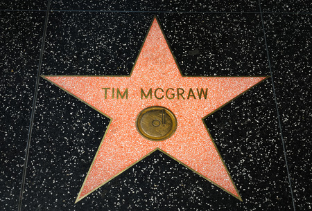 HOLLYWOOD, CAUSA - APRIL 18, 2015: Tim McGraw star on the Hollywood Walk of Fame. The Hollywood Walk of Fame is made up of brass stars embedded in the sidewalks on Hollywood Blvd.