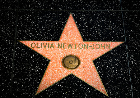 famous industries: HOLLYWOOD, CAUSA - APRIL 18, 2015 Olivia Newton-John star on the Hollywood Walk of Fame. The Hollywood Walk of Fame is made up of brass stars embedded in the sidewalks on Hollywood Blvd.