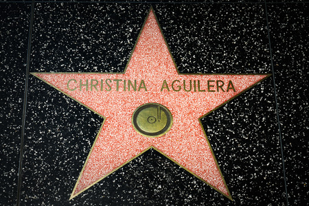 famous industries: HOLLYWOOD, CAUSA - APRIL 18, 2015 Christina Aguilera star on the Hollywood Walk of Fame. The Hollywood Walk of Fame is made up of brass stars embedded in the sidewalks on Hollywood Blvd. Editorial