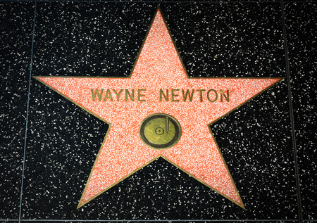 famous industries: HOLLYWOOD, CAUSA - APRIL 18, 2015 Wayne Newton star on the Hollywood Walk of Fame. The Hollywood Walk of Fame is made up of brass stars embedded in the sidewalks on Hollywood Blvd. Editorial
