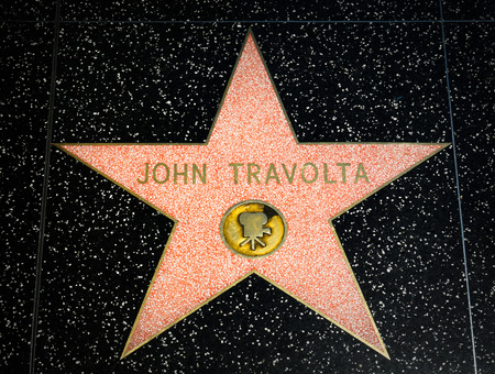 hollywood   california: HOLLYWOOD, CAUSA - APRIL 18, 2015: John Travolta star on the Hollywood Walk of Fame. The Hollywood Walk of Fame is made up of brass stars embedded in the sidewalks on Hollywood Blvd.