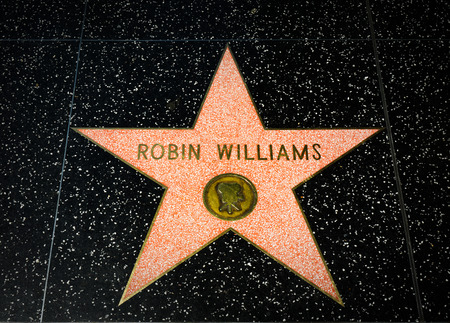 hollywood star: HOLLYWOOD, CAUSA - APRIL 18, 2015: Robin Williams star on the Hollywood Walk of Fame. The Hollywood Walk of Fame is made up of brass stars embedded in the sidewalks on Hollywood Blvd. Editorial