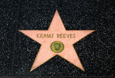 hollywood   california: HOLLYWOOD, CAUSA - APRIL 18, 2015: Keanu Reeves star on the Hollywood Walk of Fame. The Hollywood Walk of Fame is made up of  brass stars embedded in the sidewalks on Hollywood Blvd.