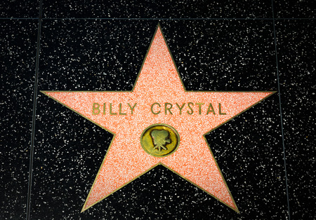 famous industries: HOLLYWOOD, CAUSA - APRIL 18, 2015: Billy Crystal star on the Hollywood Walk of Fame. The Hollywood Walk of Fame is made up of brass stars embedded in the sidewalks on Hollywood Blvd.