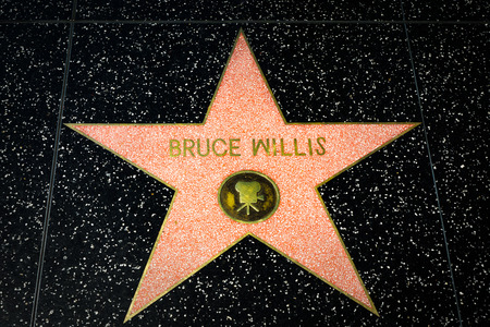 willis: HOLLYWOOD, CAUSA - APRIL 18, 2015: Bruce Willis star on the Hollywood Walk of Fame. The Hollywood Walk of Fame is made up of brass stars embedded in the sidewalks on Hollywood Blvd. Editorial
