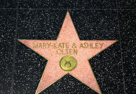 famous industries: HOLLYWOOD, CAUSA - APRIL 18, 2015: Marty Kate and Ashley Olson star on the Hollywood Walk of Fame. The Hollywood Walk of Fame is made up of brass stars embedded in the sidewalks on Hollywood Blvd.