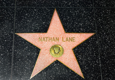 famous industries: HOLLYWOOD, CAUSA - APRIL 18, 2015: Nathan Lane star on the Hollywood Walk of Fame. The Hollywood Walk of Fame is made up of brass stars embedded in the sidewalks on Hollywood Blvd.