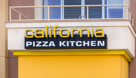 specializes: VALENCIA, CAUSA - MAY 17, 2015: California Pizza Kitchen exterior. California Pizza Kitchen is a casual dining restaurant chain that specializes in California-style pizza. Editorial