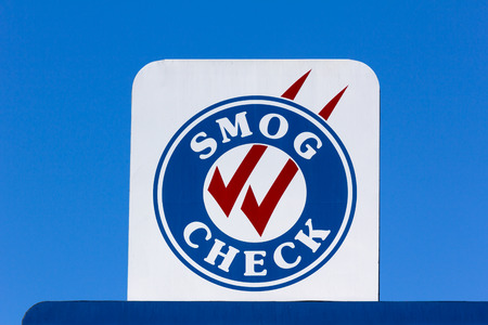 a check: Smog Check sign at automotive repair shop in the United States
