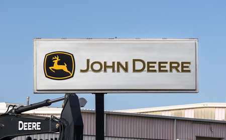 deere: LOS ANGELES, CAUSA - JULY 11, 2015: John Deere equipment dealership sign and logo. Deere & Company is an American corporation that manufactures agricultural, construction and lawn care equipment. Editorial