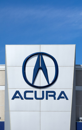 automaker: LOS ANGELES, CAUSA - JULY 11, 2015: Acura automobile dealership sign and logo. Acura is the luxury vehicle division of Japanese automaker Honda.