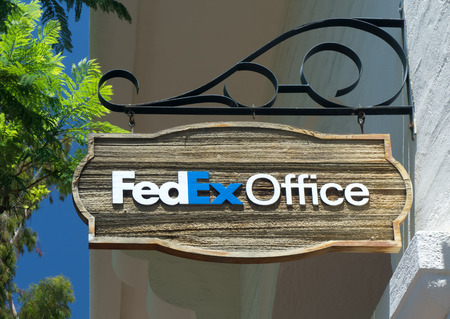 building a chain: SANTA BARBARA, CAUSA - JULY 26, 2015: FedEx Office Building. FedEx Office is a chain of stores  providing a retail outlet for FedEx Express and FedEx Ground shipping, as well as printing, copying, and binding services. Editorial
