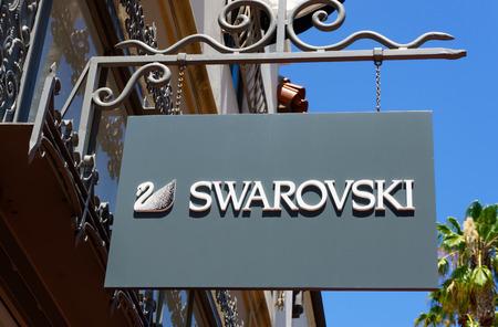 swarovski: SANTA BARBARA, CAUSA - JULY 26, 2015: Swarovski store and sign. The Swarovski Crystal range includes crystal glass sculptures and luxury home decor.