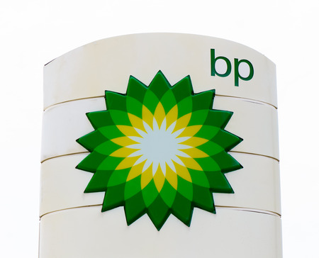 bp: AMES, IAUSA - AUGUST 6, 2015: BP gas station exterior sign. BP is a British multinational petroleum company.