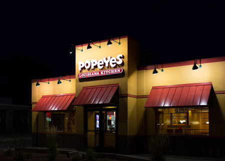 soul food: BLOOMINGTON, MNUSA - AUGUST 5, 2015: Popeyes Louisiana Kitchen exterior. Popeyes Louisiana Kitchen is an American chain of fried chicken fast food restaurants.