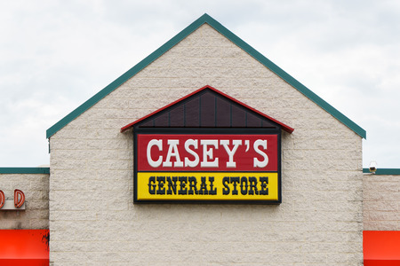 convenience store: GRINNELL, IAUSA - AUGUST 8, 2015: Caseys General Store exterior and sign. Caseys General Stores, Inc., is a chain of convenience stores in the United States.