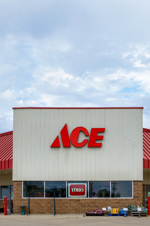 GRINNELL, IAUSA - AUGUST 8, 2015: Ace hardware store exterior and sign. he Ace Hardware Corporation is a retailers cooperative in the United States.