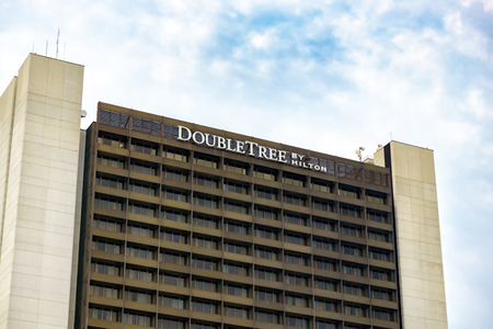 hotel exterior: BLOOMINGTON, MNUSA - August 13, 2015: Double Tree by Hilton hotel exterior. Hilton is an international chain of full service hotels and resorts and the flagship brand of Hilton Worldwide.