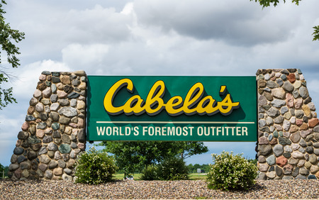 fishingpole: OWATONNA, MNUSA - AUGUST 9, 2015: Cabelas retail exterior. Cabelas retails hunting, fishing, camping, shooting, and related outdoor recreation merchandise.