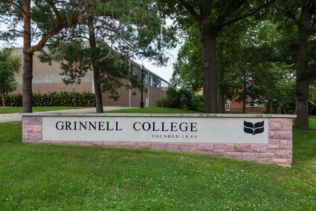 entrance sign: GRINNELL, IAUSA - AUGUST 8, 2015: Entrance sign on the campus of Grinell College. Grinnell College is a private liberal arts college  known for its rigorous academics and tradition of social responsibility. Editorial