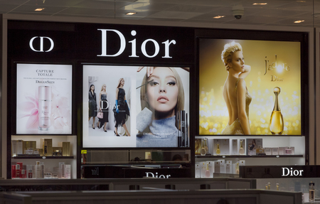 french perfume: LOS ANGELES, CAUSA - AUGUST 4, 2015: Christian Dior store display. Christian Dior is a French manufacturer and marketer of high-end skincare, makeup, fragrance and hair care products.
