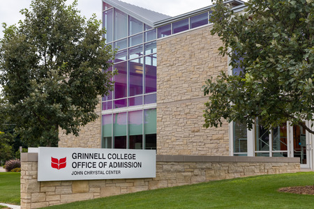 university admission: GRINNELL, IAUSA - AUGUST 8, 2015: Grinnell College Office of Admission on the campus of Grinell College. Grinnell College is a private liberal arts college  known for its rigorous academics and tradition of social responsibility. Editorial