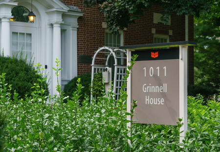 rigorous: GRINNELL, IAUSA - AUGUST 8, 2015: Grinnell House on the campus of Grinell College. Grinnell College is a private liberal arts college  known for its rigorous academics and tradition of social responsibility.