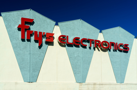 consumer electronics: BURBANK, CAUSA - SEPTEMBER 19, 2015: Frys Electronics store exterior. Frys is a big-box store retailer of software, consumer electronics, household appliances and computer hardware. Stock Photo