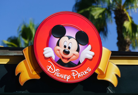 ANAHEIM, CAUSA - OCTOBER 10, 2015: Mickey Mouse on sign at Downtown Disney. Downtown Disney is the name of an outdoor shopping, dining, and entertainment complex next to Disneyland. Publikacyjne
