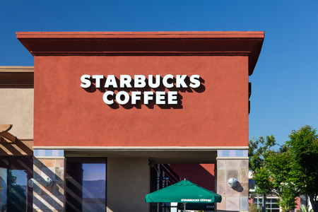VALENCIA, CAUSA - AUGUST 14, 2014: Starbucks Coffee shop exterior. Starbucks is an American global coffee company and coffeehouse chain based in Seattle, Washington.