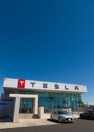 automobile dealership: BUENA PARK, CAUSA - OCTOBER 10, 2015: Tesla Motors automobile dealership. Tesla Motors, Inc. is an American automotive and energy storage company.