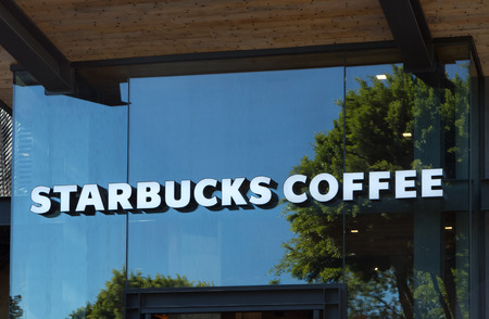 famous industries: ANAHEIM, CAUSA - OCTOBER 10, 2015:Starbucks Coffee shop exterior. Starbucks is an American global coffee company and coffeehouse chain based in Seattle, Washington.