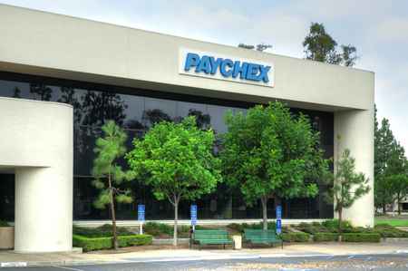 payroll: COSTA MESA, CAUSA - OCTOBER 17, 2015: Paychex corporate building. Paychex, Inc. is a provider of payroll, human resource, and benefits outsourcing solutions.