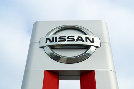 nissan: COSTA MESA, CAUSA - OCTOBER 17, 2015: Nissan Motors automobile dealership and sign.  Nissan Motors is is a Japanese multinational automotive manufacturer headquartered in Japan.